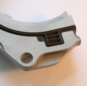 Rubber to metal bonding for engine